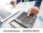 businessman holding a pen is... | Shutterstock . vector #1030315822