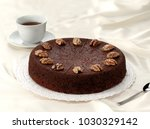 chocolate and walnuts cake | Shutterstock . vector #1030329142