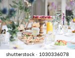 a beautiful styled table with... | Shutterstock . vector #1030336078