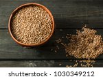 flax seeds on a black... | Shutterstock . vector #1030349212