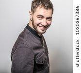 handsome man pose in studio.   Shutterstock . vector #1030367386