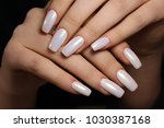 beautiful long nails on a... | Shutterstock . vector #1030387168