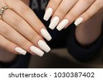 beautiful long nails on a... | Shutterstock . vector #1030387402
