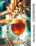 hand of bartender pouring a... | Shutterstock . vector #1030389358