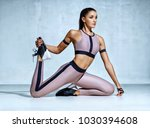 young fitness woman doing... | Shutterstock . vector #1030394608