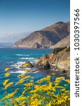Small photo of Scenic view of rugged coastline of Big Sur with Santa Lucia Mountains and Big Creek Bridge along famous Highway 1 in beautiful golden evening light at sunset in summer, California Central Coast, USA