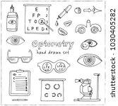 optometry hand drawn doodle set....   Shutterstock .eps vector #1030405282