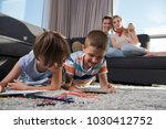 happy young family playing... | Shutterstock . vector #1030412752