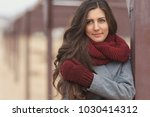 beautiful woman in grey coat...   Shutterstock . vector #1030414312