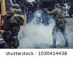 the storming of the bus by... | Shutterstock . vector #1030414438