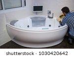 installation of modern bath  ...   Shutterstock . vector #1030420642