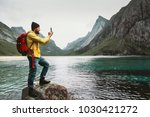 tourist man taking selfie by... | Shutterstock . vector #1030421272