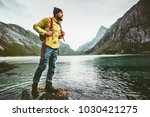 man backpacker walking on... | Shutterstock . vector #1030421275
