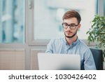 young intern working at the... | Shutterstock . vector #1030426402