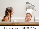 two little sisters play in a...   Shutterstock . vector #1030428946