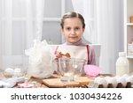 portrait of girl in kitchen...   Shutterstock . vector #1030434226