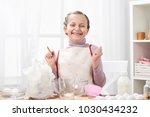 portrait of girl in kitchen...   Shutterstock . vector #1030434232