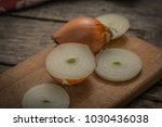 fresh onions vegetables on a... | Shutterstock . vector #1030436038