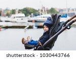 baby sitting in a pram  buggy...   Shutterstock . vector #1030443766