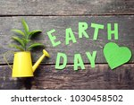 inscription earth day with... | Shutterstock . vector #1030458502
