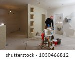 a young man at work painter... | Shutterstock . vector #1030466812