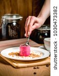 beet mousse and scattered nuts... | Shutterstock . vector #1030473382