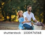 young happy couple riding a... | Shutterstock . vector #1030476568