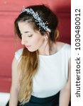 young beautiful bride with a...   Shutterstock . vector #1030480012