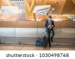businessman at the airport... | Shutterstock . vector #1030498768