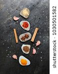 colorful spices on pebbles in... | Shutterstock . vector #1030501582
