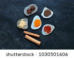 colorful spices on pebbles in... | Shutterstock . vector #1030501606