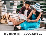 couple asian travelers are... | Shutterstock . vector #1030529632