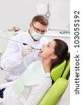 The dentist treats teeth of patient - stock photo