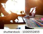 graphic designer at work.... | Shutterstock . vector #1030552855