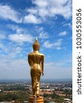 golden buddha statue on the... | Shutterstock . vector #1030553056