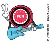 with guitar funfair coin mascot ... | Shutterstock .eps vector #1030561396