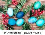 easter eggs on wooden background | Shutterstock . vector #1030574356