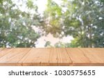 image of wood table in front of ...   Shutterstock . vector #1030575655