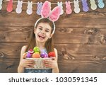 cute little child wearing bunny ... | Shutterstock . vector #1030591345
