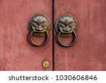 on the red door of the beast... | Shutterstock . vector #1030606846