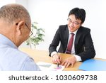sales person and senior man at...   Shutterstock . vector #1030609738