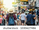 back side of young asian... | Shutterstock . vector #1030627486