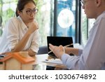 realtor talk with client. real... | Shutterstock . vector #1030674892