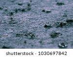 rain water drop falling to the... | Shutterstock . vector #1030697842