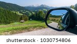 view from the car's mirror in... | Shutterstock . vector #1030754806