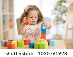 cute child playing with block... | Shutterstock . vector #1030761928