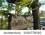 wooden welcome signage | Shutterstock . vector #1030778182
