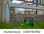 water hose reel with under...   Shutterstock . vector #1030783582