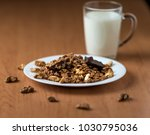 muesli with chocolate and nuts... | Shutterstock . vector #1030795036