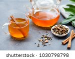 tea with cinnamon in glass cup... | Shutterstock . vector #1030798798